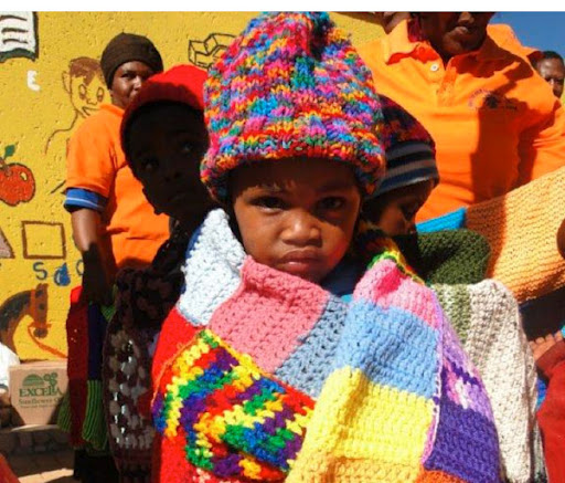 13-knit-a-square-child-and-blanket.jpg